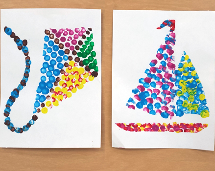 elementary pointillism project depicting a kite and a sailboat